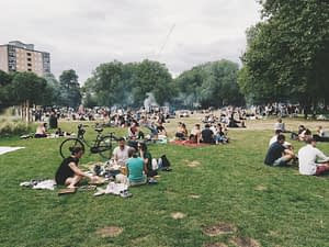 A community of people socializing. Photo by Robert Bye on Unsplash