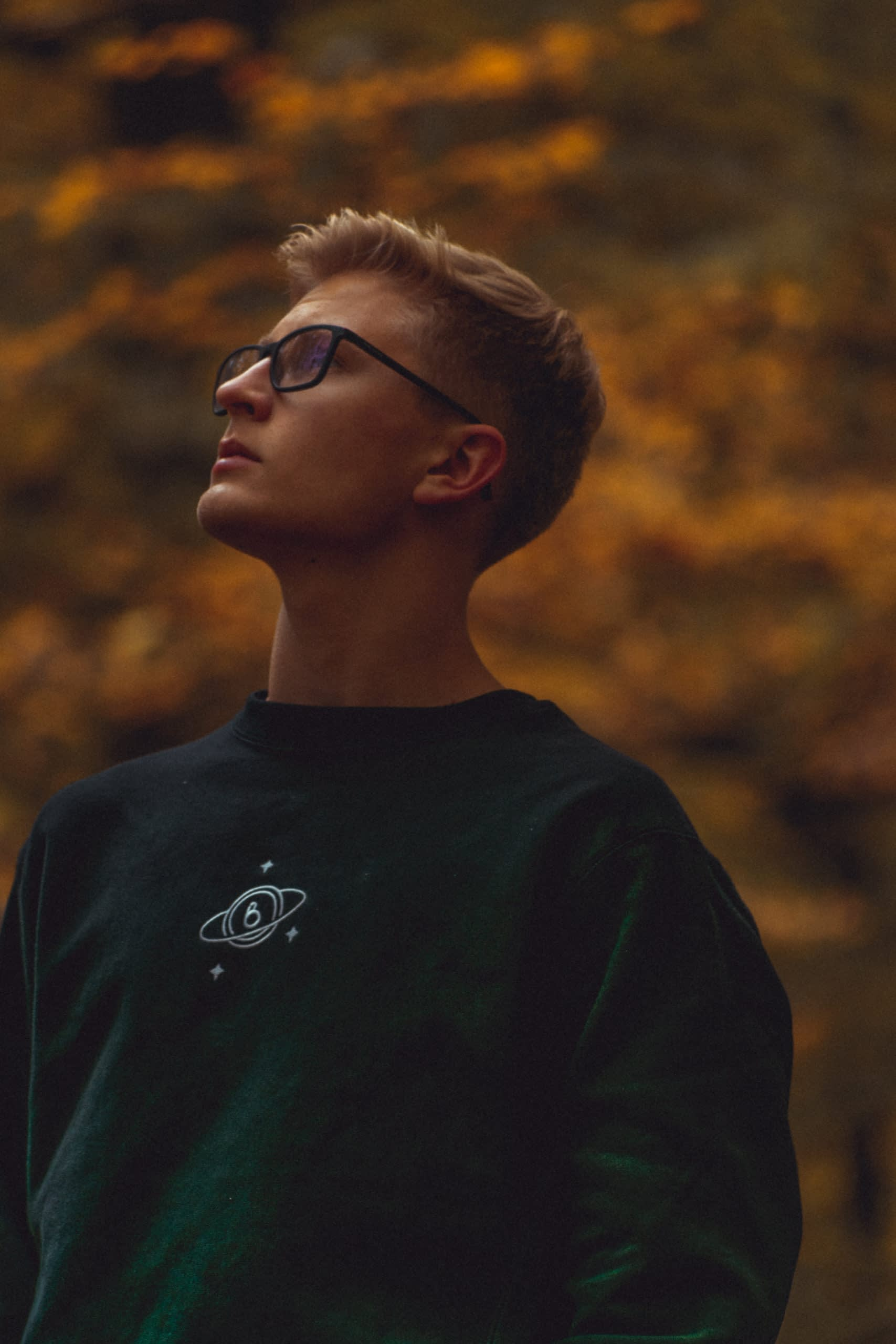 This is a self-portrait of the Dream. Pullover. I decided to leave the green haze on the sweatshirt because it gives the feeling of a dreamy or universe haze which suits the embroidered graphic.